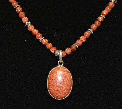 Brown Sandstone with Oval Pendant Detail