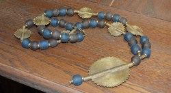 Long gashi Bead with Lost wax Medallion Detail